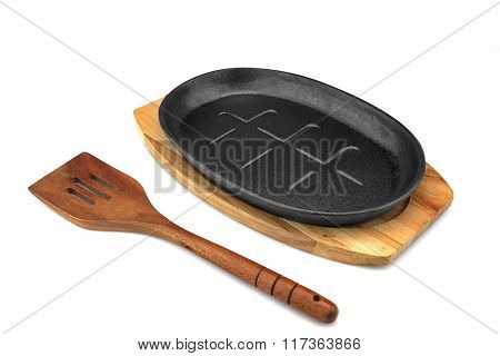 Cast Iron Serving Pan On Wood Plate, Spatula White Isolated