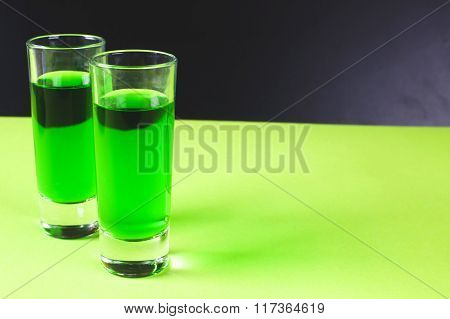 Two Glasses Of Sweet Alcoholic Green Liqueur