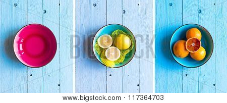 Colorful Orange fruits over a light blue painted wood table with a simmetric position.