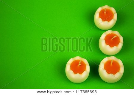 Easter Candles On A Green Background