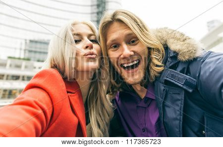 Young Couple Spending Time In The Afternoon In Milan City Center And Taking Selfies