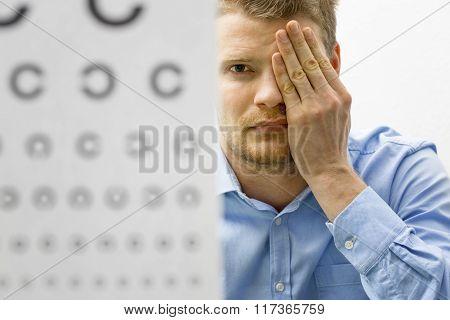 Eyesight Check. Male Patient Under Eye Vision Examination