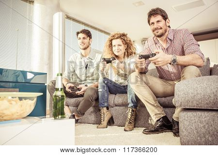 Friends Playing Video Games In The Living Room