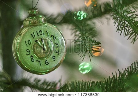 old Clock glass figure on christmas tree close up green lights abies stick, USSR toy