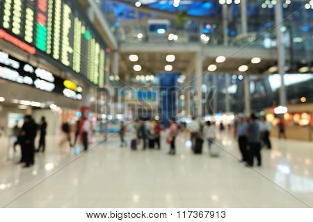 Blur Photo of passenger see the flight information displays in Suvarnabhumi Airport