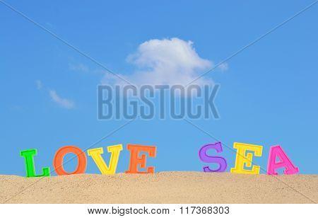 Love Sea Letters On A Beach Sand