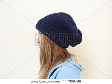 girl profile wearing a crochet beanie