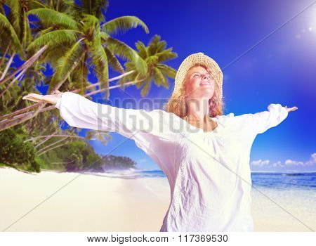 Woman Relaxing on the Beach Happiness Concept