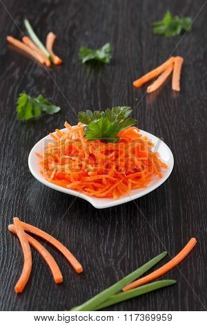 Carrot On A White Plate.