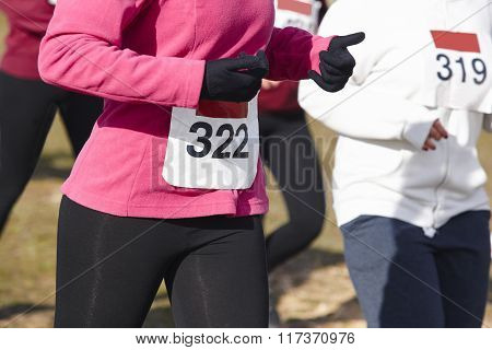 Female Athletic Runners On A Cross Country Race. Outdoor Circuit