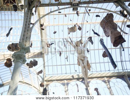 MADRID SPAIN - NOVEMBER 14 2015: Exhibition Banish the Faceless / Reward your Grace by Danh Vo in the Palacio de Cristal (Crystal Palace) in the Buen Retiro Park Madrid Spain.