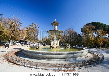 MADRID SPAIN - NOVEMBER 14 2015: Fountain the Buen Retiro Park one of the main attractions of Madrid Spain.