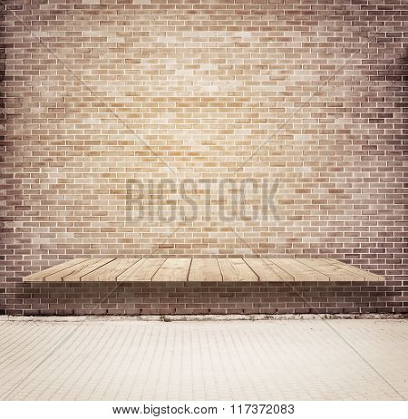 Brick grunge weathered brown wall with wooden shelf, table surface, walkway