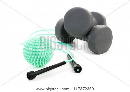 Skipping rope, dumbbells and massage ball isolated on white background