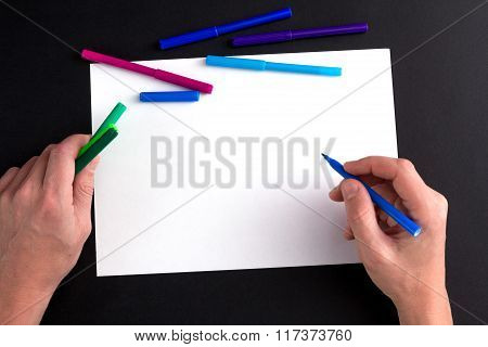 the man's hand ready to draw a picture