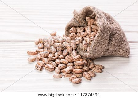brown beans, healthy food on white background