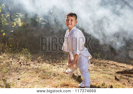 Beautiful cute baby standing in a pose of readiness to fight in nature