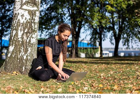 Beautiful girl studying yoga in the park