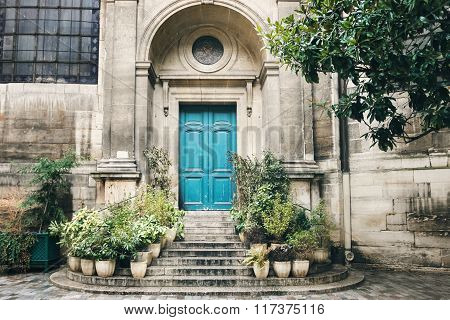 Old Turquoise Door With Stairs And Flower Pots