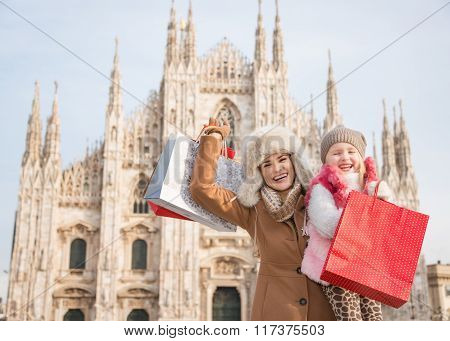 Mother And Daughter With Shopping Bags Rejoicing Near Duomo