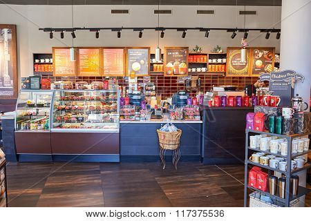 GENEVA, SWITZERLAND - NOVEMBER 18, 2015: interior of Starbucks Cafe. Starbucks Corporation is an American global coffee company and coffeehouse chain based in Seattle, Washington