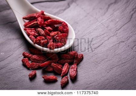 Goji berries,healthy superfood,diet concept , on black stone