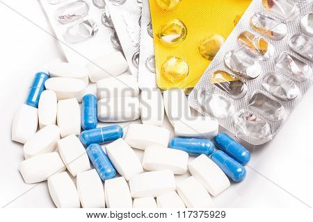 Plate with white and blue medical pills for treating diseases