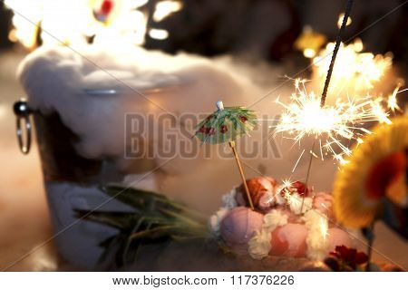 Sparkler on an ice creme buffet