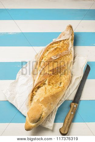 Loaf Of Bread On A Rustic Mediterranean Style Wooden Table..