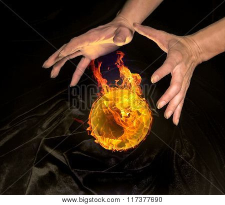 Burning Crystal Ball And Hands
