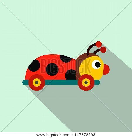 Colored ladybug toy on a wheels flat icon