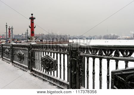 ST. PETERSBURG, RUSSIA - JANUARY 17, 2016: View from Palace bridge to river Neva and the spit of Vasilievsky island. The bridge was built in 1911-1916, but the iron fencing installed in 1939