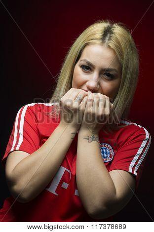 Galati, Romania February 3 2016. Studio Shot Of Bayern Munich Fan. Blonde Woman.
