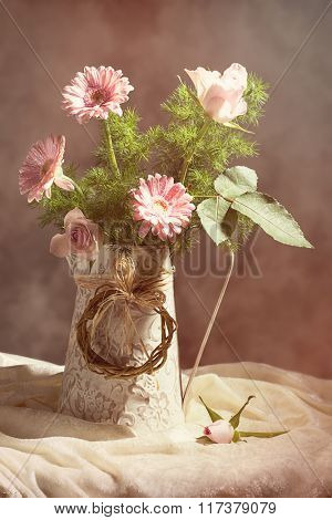 Flower arrangement still life with pink roses and gerbera