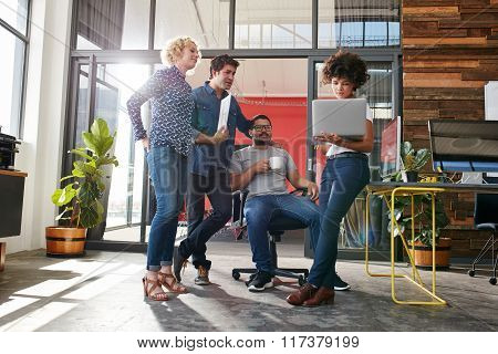 Multiracial Group Of Designers Meeting In Modern Office