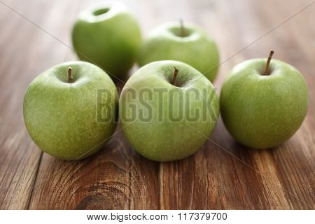 Green apples on a rustic table