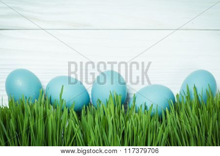 Easter concept with colored eggs on wooden background