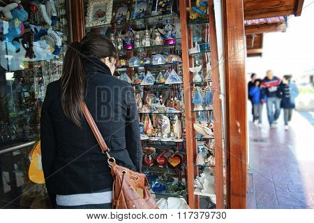 girl looking at a gift shop