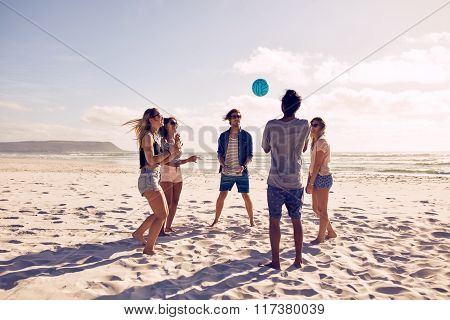 Young People Playing With Ball At The Beach