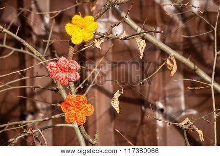 Crochet flowers on a fence