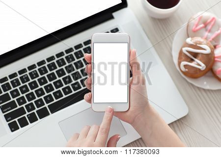 Female Hand Holding White Phone With Isolated Screen And Laptop