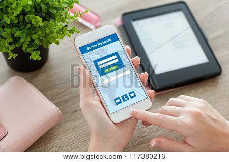 Female Hands Holding Phone With Social Network On The Screen