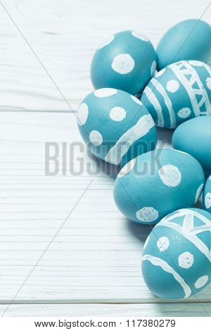 Easter concept with colorful eggs on wooden background