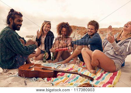 Friends Enjoying At Beach Party