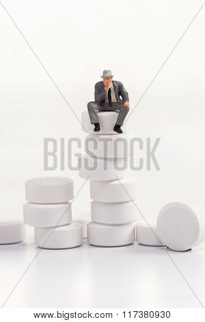 miniature people - people posing in front of pills