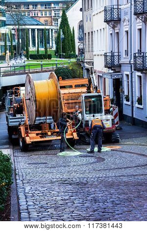 Construction Workers Make Repair Urban  Engineering. Replacement Of  Cable Laying Modern Optical Com