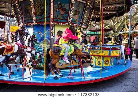 Unidentified Children On Christmas Market Carousel In  Baden-baden, Germany