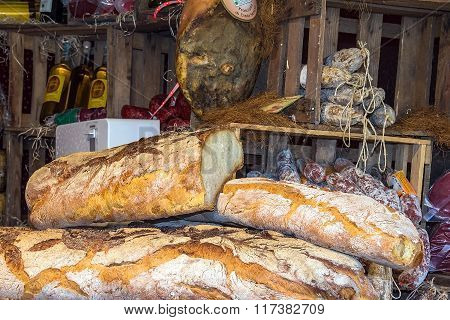 Bread, Sausage And Olive Oil On The Christmas Market