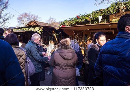 Unidentified People tasted holiday meals at Christmas Market In  Baden-Baden, Germany
