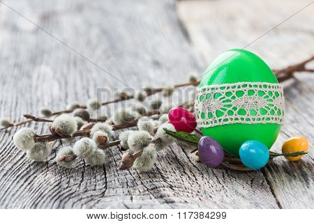 Green Easter Egg Decorated With Lace And Willow Branch On Wooden Background. Selective Focus, Copy S